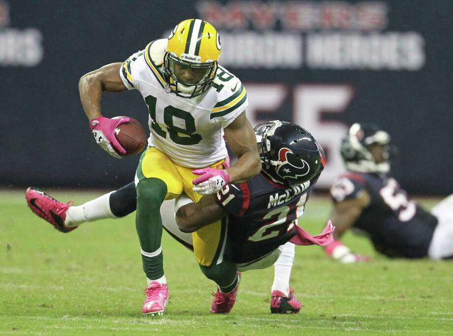 Houston Texans defensive back Brice McCain (21) brings down Green Bay Packers wide receiver Randall Cobb (18) during the third quarter at Reliant Stadium on Sunday, Oct. 14, 2012, in Houston. Photo: Karen Warren, Houston Chronicle / © 2012  Houston Chronicle