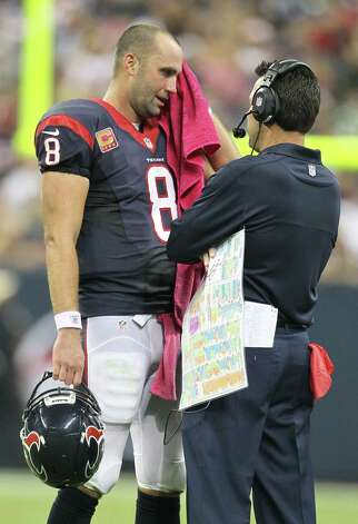 Houston Texans quarterback Matt Schaub wipes his brow as he talke with head coach Gary Kubiak during the second quarter against the Green Bay Packers at Reliant Stadium on Sunday, Oct. 14, 2012, in Houston. Photo: Karen Warren, Houston Chronicle / © 2012  Houston Chronicle