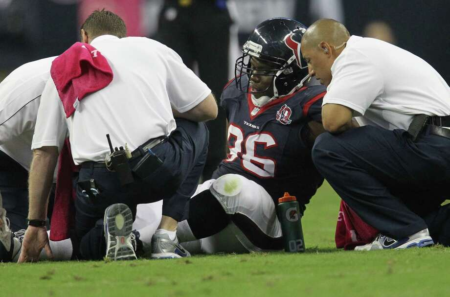 Houston Texans defensive end Tim Jamison receives treatment after an injury during the first quarter against the Green Bay Packers at Reliant Stadium on Sunday, Oct. 14, 2012, in Houston. Photo: Karen Warren, Houston Chronicle / © 2012  Houston Chronicle
