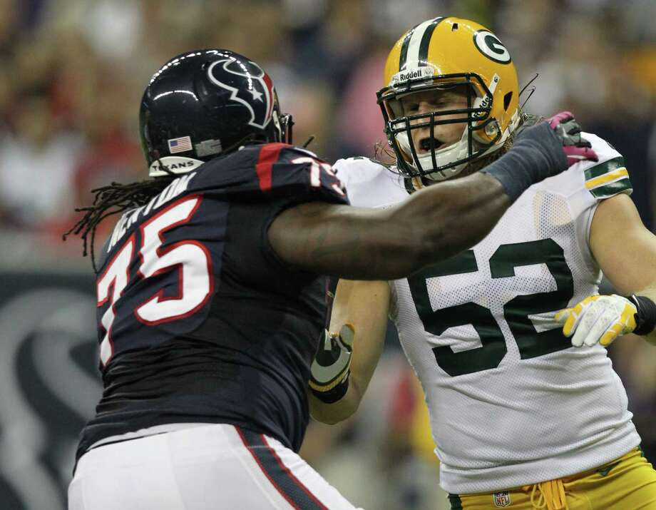Houston Texans tackle Derek Newton (75) blocks against Green Bay Packers outside linebacker Clay Matthews (52) during the first quarter at Reliant Stadium, Sunday, Oct. 14, 2012, in Houston. Photo: Nick De La Torre, Houston Chronicle / © 2012  Houston Chronicle
