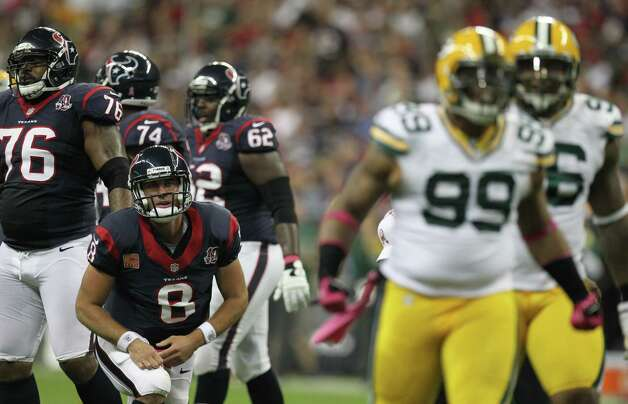Houston Texans quarterback Matt Schaub (8) picks himself up after being sacked by Green Bay Packers defensive end Jerel Worthy (99) during the first quarter at Reliant Stadium, Sunday, Oct. 14, 2012, in Houston. Photo: Nick De La Torre, Houston Chronicle / © 2012  Houston Chronicle