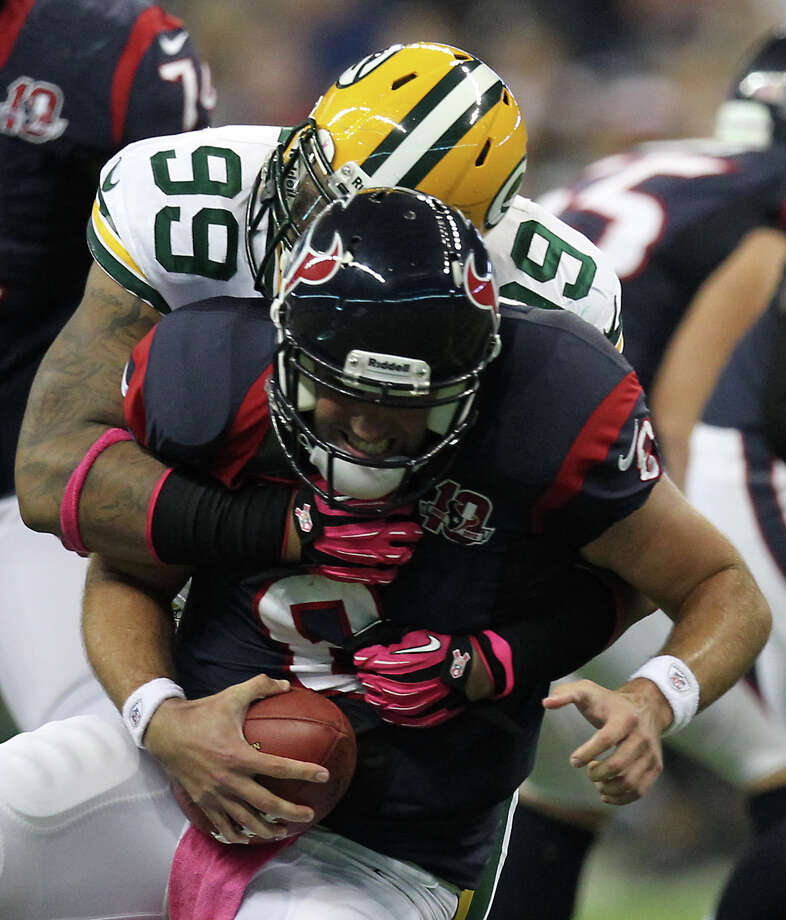 Green Bay Packers defensive end Jerel Worthy (99) sacks Houston Texans quarterback Matt Schaub (8) during the first quarter at Reliant Stadium, Sunday, Oct. 14, 2012, in Houston. Photo: Nick De La Torre, Houston Chronicle / © 2012  Houston Chronicle