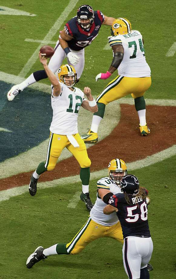 Green Bay Packers quarterback Aaron Rodgers (12) throws a 41-yard touchdown pass to Jordy Nelson during the first half against the Houston Texans at Reliant Stadium on Sunday, Oct. 14, 2012, in Houston. Photo: Smiley N. Pool, Houston Chronicle / © 2012  Houston Chronicle