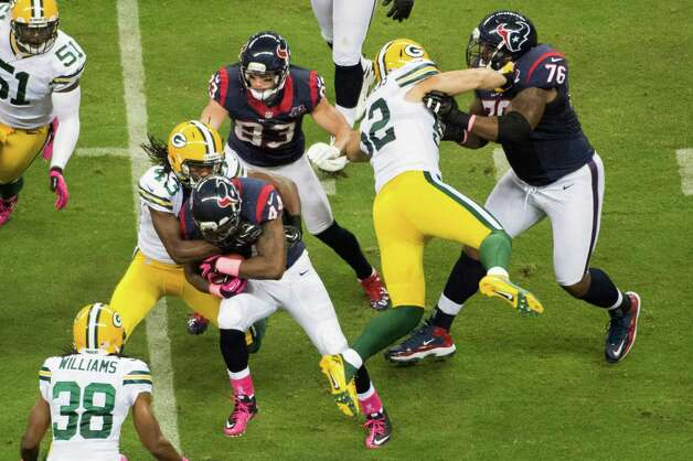 Green Bay Packers strong safety M.D. Jennings (43) makes a stop on Houston Texans running back Ben Tate (44) as Texans tackle Duane Brown (76) tries to put a block on Packers outside linebacker Clay Matthews (52) during the first quarter at Reliant Stadium on Sunday, Oct. 14, 2012, in Houston. Photo: Smiley N. Pool, Houston Chronicle / © 2012  Houston Chronicle