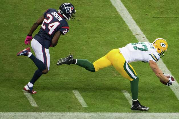 Green Bay Packers wide receiver Jordy Nelson (87) beats Houston Texans cornerback Johnathan Joseph (24) to the end zone on a 41-yard pass from Aaron Rodgers during the first quarter at Reliant Stadium on Sunday, Oct. 14, 2012, in Houston. Photo: Smiley N. Pool, Houston Chronicle / © 2012  Houston Chronicle