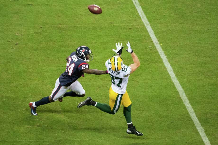 Green Bay Packers wide receiver Jordy Nelson (87) beats Houston Texans cornerback Johnathan Joseph (24) on a 41-yard pass for a touchdown from Aaron Rodgers during the first quarter at Reliant Stadium on Sunday, Oct. 14, 2012, in Houston. Photo: Smiley N. Pool, Houston Chronicle / © 2012  Houston Chronicle