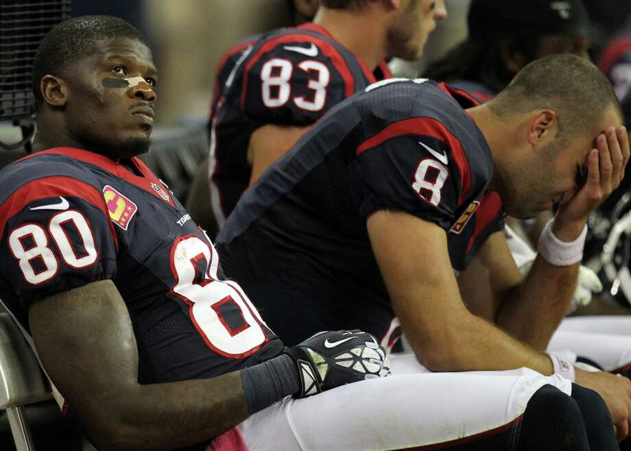 Houston Texans wide receiver Andre Johnson (80) and quarterback Matt Schaub (8) react on the bench during the fourth quarter against the Green Bay Packers at Reliant Stadium, Sunday, Oct. 14, 2012, in Houston. Photo: Nick De La Torre, Houston Chronicle / © 2012  Houston Chronicle