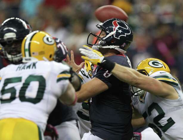 Houston Texans quarterback Matt Schaub (8) gets off a pass as he is hit by Green Bay Packers outside linebacker Clay Matthews (52) during the fourth quarter at Reliant Stadium, Sunday, Oct. 14, 2012, in Houston. Photo: Nick De La Torre, Houston Chronicle / © 2012  Houston Chronicle