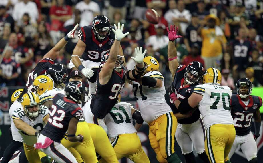 Houston Texans outside linebacker Connor Barwin (98) jumps up onto the pile on a Green Bay Packers field goal attempt to commit a costly personal foul penalty during the third quarter at Reliant Stadium, Sunday, Oct. 14, 2012, in Houston. Photo: Nick De La Torre, Houston Chronicle / © 2012  Houston Chronicle
