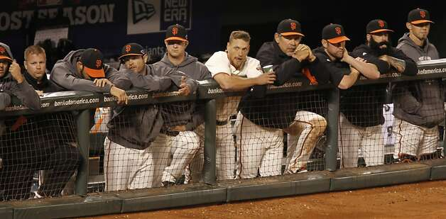 The Giants watch the 8th inning from the dugout down 6 to 4 during game 1 of the NLCS at AT&T Park on Sunday, Oct. 14, 2012 in San Francisco, Calif. Photo: Michael Macor, The Chronicle