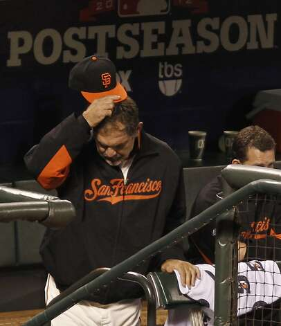 Giants' coach Bruce Bochy is seen in the dugout in the 8th inning during game 1 of the NLCS at AT&T Park on Sunday, Oct. 14, 2012 in San Francisco, Calif. Photo: Michael Macor, The Chronicle