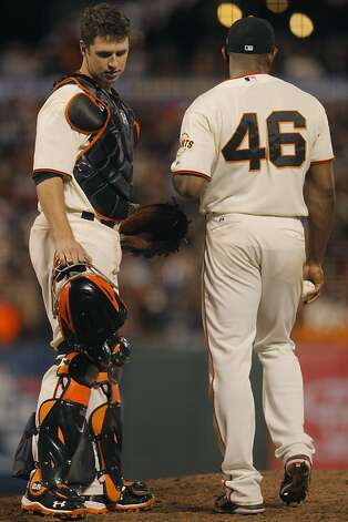 San Francisco Giants catcher Buster Posey (l to r) and pitcher Santiago Casilla confer on the pitcher's mound during the eighth inning of  as the San Francisco Giants  play the St. Louis Cardinals in Game 1 of the National League Championship Series on Sunday, October 14, 2012 in San Francisco, Calif.  Final Score: St. Louis Cardinals 6: San Francisco Giants 4. Photo: Lea Suzuki, The Chronicle