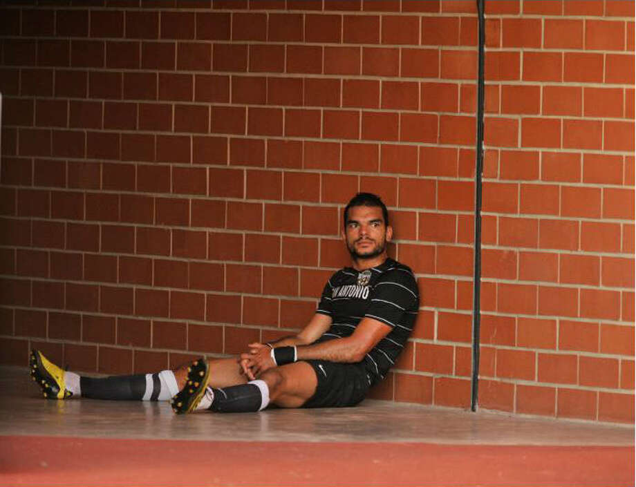 The Scorpions' Pablo Campos sits in front of the locker room after being issued a red card and ejected during the first half. Robin Jerstad / For the Express-News