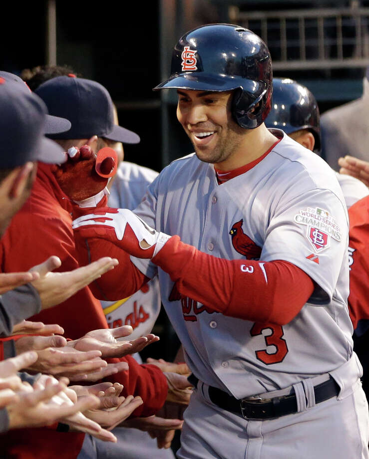St. Louis Cardinals' Carlos Beltran (3) is congratulated in the dugout after hitting a two-run home run during the fourth inning of Game 1 of baseball's National League championship series against the San Francisco Giants Sunday, Oct. 14, 2012, in San Francisco. (AP Photo/David J. Phillip) Photo: David J. Phillip