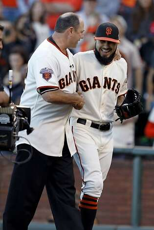 Ex-Giant/ex-Cardinal Will Clark (left) threw the ceremonial first pitch to Sergio Romo, who arrived just in time to relieve Lou Seal. Photo: Brant Ward, The Chronicle