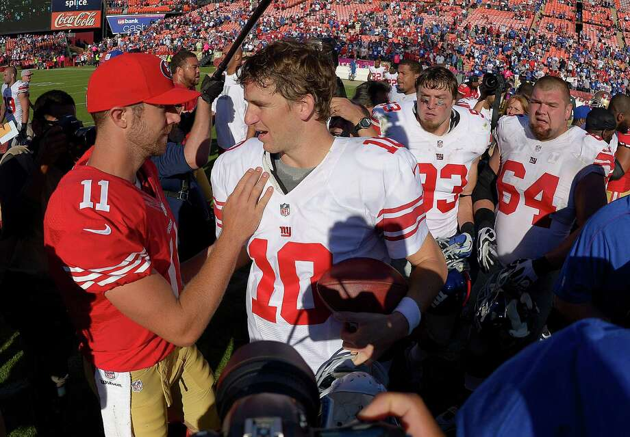 San Francisco 49ers quarterback Alex Smith (11) greets New York Giants quarterback Eli Manning (10) after an NFL football game in San Francisco, Sunday, Oct. 14, 2012. The Giants won 26-3. (AP Photo/Mark J. Terrill) Photo: Mark J. Terrill