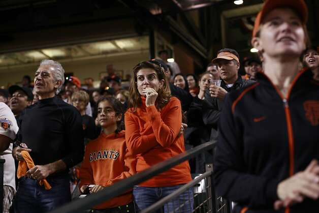 Ani Ayanian, of San Francisco, bites her nails as the Giants bat during the 4th inning again the St. Louis Cardinals in NLCS Game 1 on Sunday Oct. 14, 2012 in San Francisco, Calif. Final Score 4-6 Cardinals Photo: Mike Kepka, The Chronicle