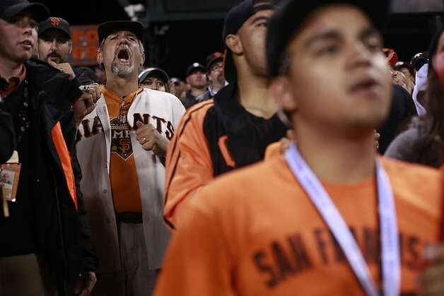 Marc Rose (2nd to left), of Hollister,  watches a bad play as the San Francisco Giants play the St. Louis Cardinals in NLCS Game 1 on Sunday Oct. 14, 2012 in San Francisco, Calif. Photo: Mike Kepka, The Chronicle