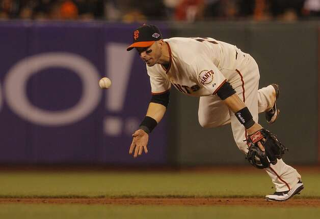 GiantsÕ third baseman Marco Scutaro tosses the ball to Brandon Crawford to get CardinalsÕ right fielder Allen Craig out at second for a double play in the fifth inning during game 1 of the NLCS at AT&T Park on Sunday, Oct. 14, 2012 in San Francisco, Calif. Photo: Lea Suzuki, The Chronicle