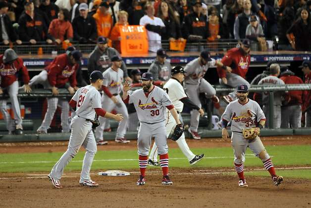 Cardinals closer Jason Motte high fives Allen Craig after the final out is tallied on Sunday. The San Francisco Giants played the St. Louis Cardinals in Game 1 of the National League Championship Series on Sunday, October 14, 2012, at AT&T Park in San Francisco, Calif. The Cardinals defeated the Giants 6-4. Photo: Carlos Avila Gonzalez, The Chronicle