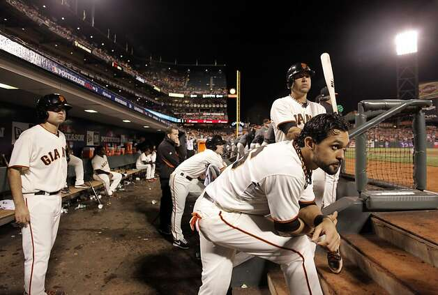 GIants' Gregor Blanco, (top)  and Angel Pagan, (front) keep a close watch on their teamates batting in the eighth inning, as the San Francisco Giants went on to lose the St. louis Cardinals 6-4 in game one of the National League Championship Series at AT&T Park,  the San Francisco, Ca.,  on Sunday Oct. 14, 2012. Photo: Michael Macor, The Chronicle