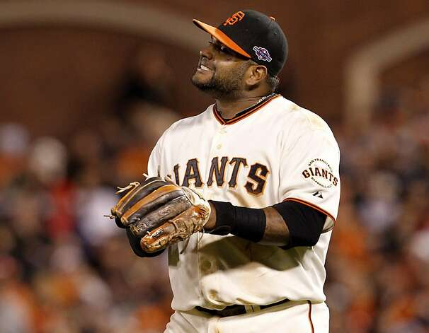 Pablo Sandoval reacted after he made an error late in the game on a throw to first base. The San Francisco Giants lost 6-4 to the St. Louis Cardinals in the first game of the league championship series Sunday Octboer 14, 2012 at AT&T park. Photo: Brant Ward, The Chronicle