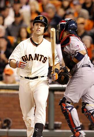 Buster Posey walked back to the dugout after striking out to end the 7th inning. The San Francisco Giants lost 6-4 to the St. Louis Cardinals in the first game of the league championship series Sunday Octboer 14, 2012 at AT&T park. Photo: Brant Ward, The Chronicle