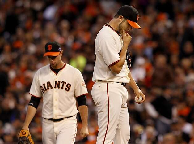 Madison Bumgarner (right) stood on the mound after giving up a home run to David Freese. The San Francisco Giants lost 6-4 to the St. Louis Cardinals in the first game of the league championship series Sunday Octboer 14, 2012 at AT&T park. Photo: Brant Ward, The Chronicle