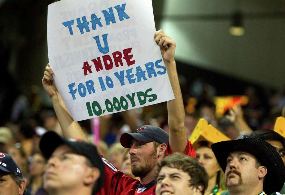 A fan at Reliant Stadium shows his support for Texans wideout Andre Johnson, who had eight catches for 75 yards on Sunday night and became the 38th player in NFL history with 10,000 receiving yards. Photo: Brett Coomer / © 2012  Houston Chronicle