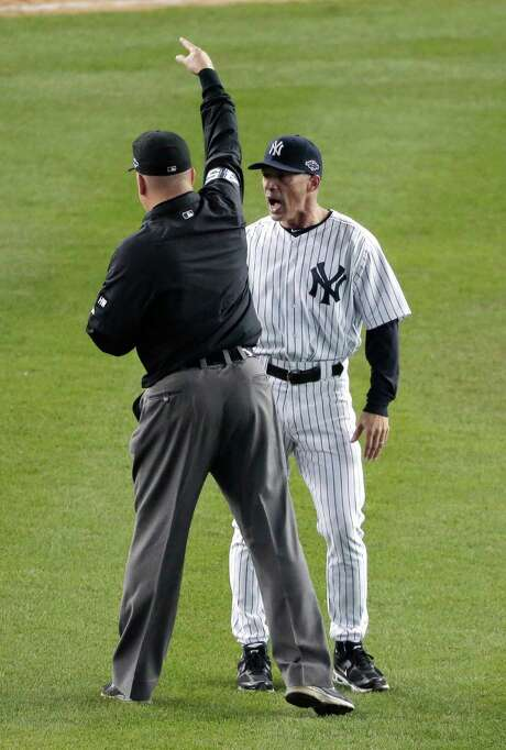Perhaps expecting a changed ruling as a gift on his 48th birthday, manager Joe Girardi disputes an eighth-inning call. His present instead was an early trip to the clubhouse. Photo: Charlie Riedel / AP
