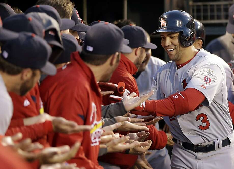 Carlos Beltran works his way down the St. Louis dugout receiving line after hitting a two-run homer in the fourth inning for the Cardinals' final runs. Photo: David J. Phillip, Associated Press