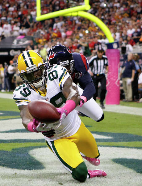 Packers wide receiver James Jones hauls in one of Aaron Rodgers' six touchdown passes. Rodgers' output matched the number of touchdown passes the Texans allowed in their first five games. Photo: Nick De La Torre / © 2012  Houston Chronicle