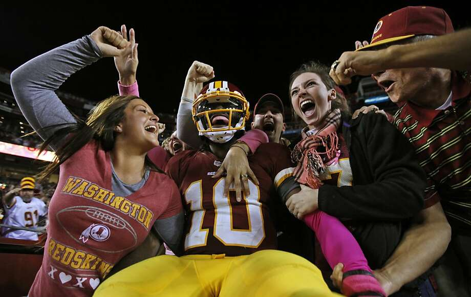 Washington Redskins quarterback Robert Griffin III (10) celebrates with fans after a 76-yard touchdown run during the second half of an NFL football game against the Minnesota Vikings, Sunday, Oct. 14, 2012, in Landover, Md. (AP Photo/Pablo Martinez Monsivais) Photo: Pablo Martinez Monsivais, Associated Press