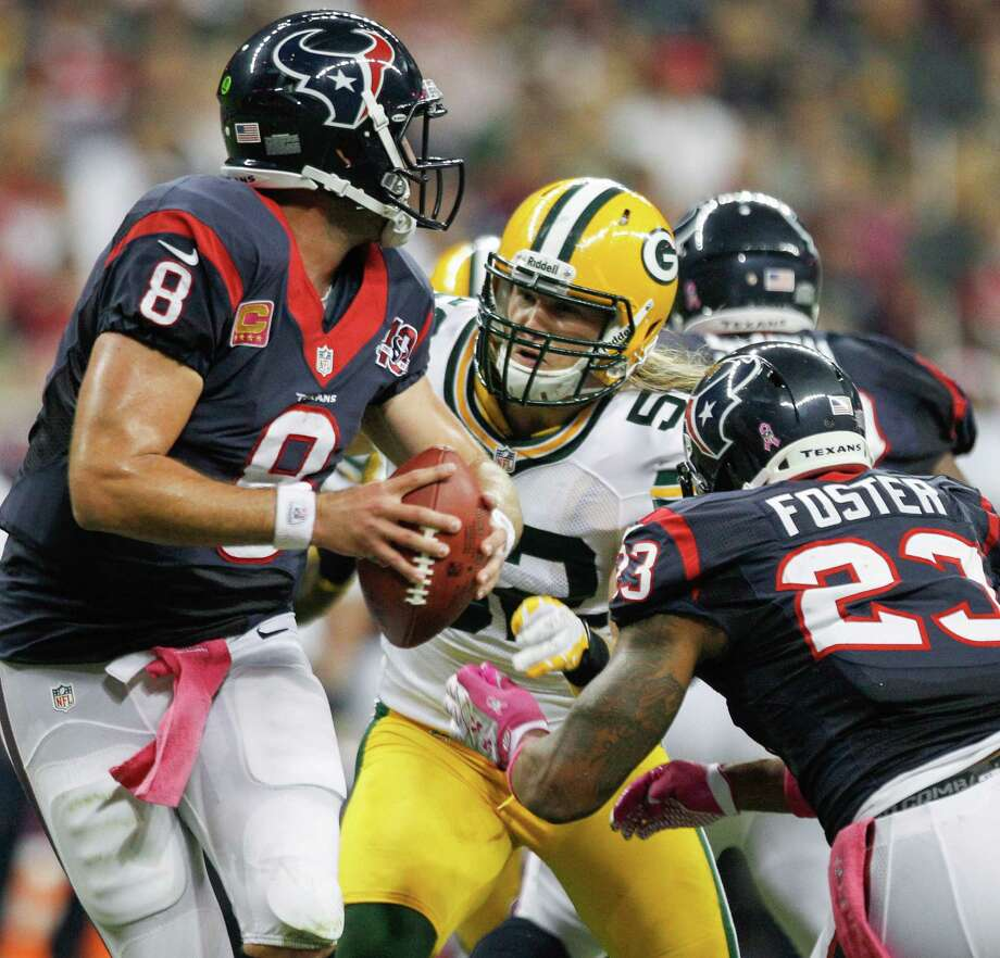 Packers outside linebacker Clay Matthews (52) applies pressure to Texans quarterback Matt Schaub (8) during the first quarter. Photo: Brett Coomer, Houston Chronicle / © 2012  Houston Chronicle