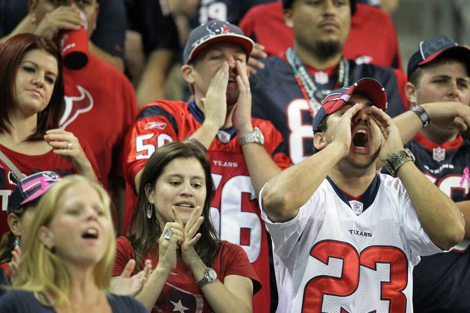 Texans fans cheer on their team against the Packers during the second quarter. Photo: Karen Warren, Houston Chronicle / © 2012  Houston Chronicle