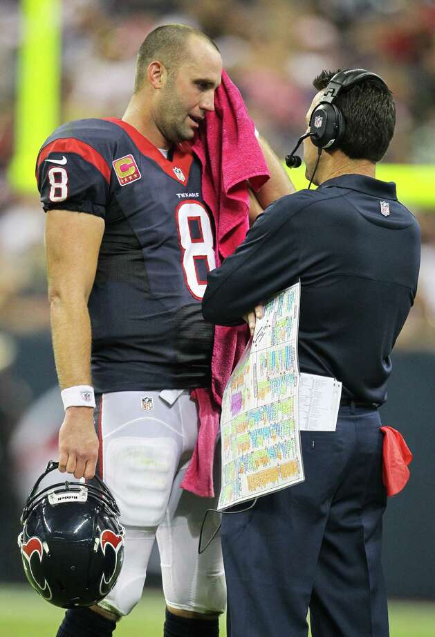 Texans quarterback Matt Schaub wipes his brow as he talks with head coach Gary Kubiak during the second quarter. Photo: Karen Warren, Houston Chronicle / © 2012  Houston Chronicle