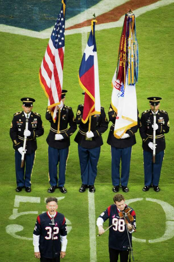 Lyle Lovett sings the national anthem before the Texans game against the Green Bay. Photo: Smiley N. Pool, Houston Chronicle / © 2012  Houston Chronicle