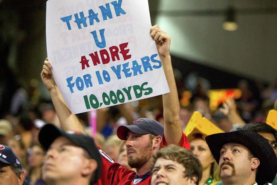 A fan holds a sign supporting Houston Texans wide receiver Andre Johnson during the second quarter. Photo: Brett Coomer, Houston Chronicle / © 2012  Houston Chronicle