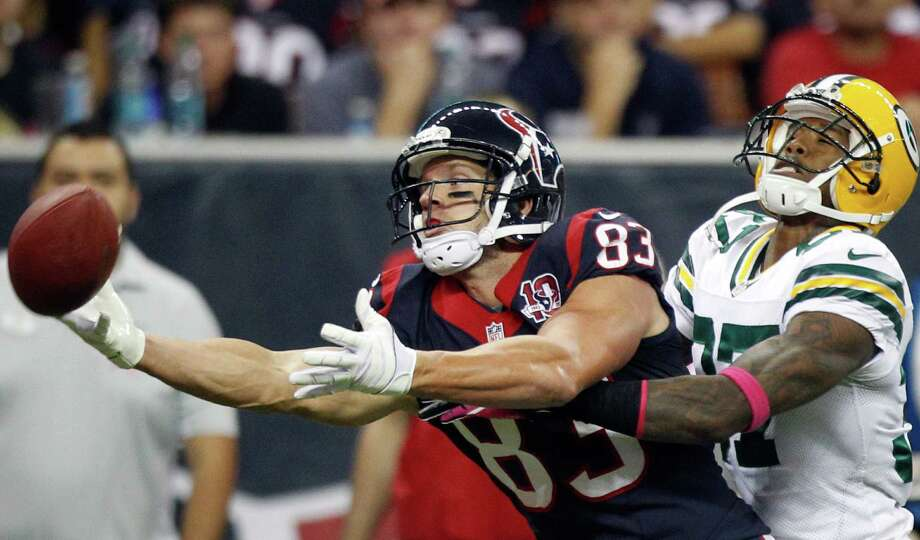 Texans wide receiver Kevin Walter (83) can't catch a pass as Green Bay cornerback Sam Shields (37) commits pass interference during the second quarter. Photo: Brett Coomer, Houston Chronicle / © 2012  Houston Chronicle