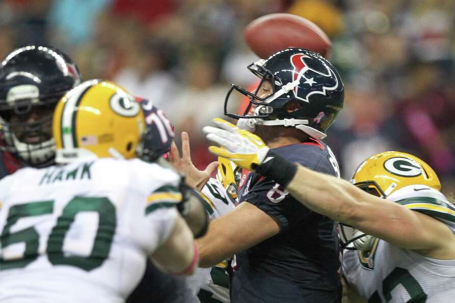 Texans quarterback Matt Schaub (8) gets off a pass as he is hit by Packers outside linebacker Clay M