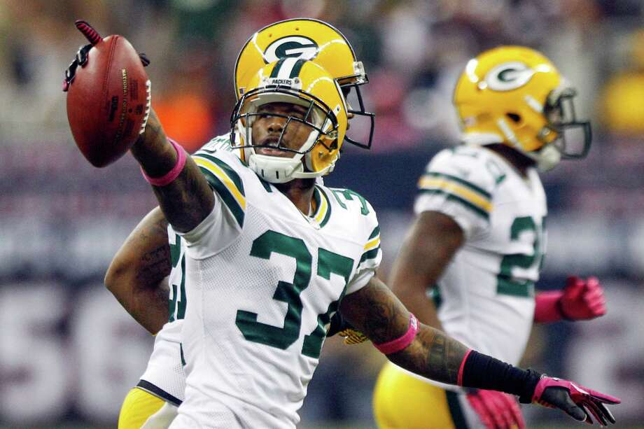 Packers cornerback Sam Shields (37) celebrates after intercepting a pass during the fourth quarter. Photo: Brett Coomer, Houston Chronicle / © 2012  Houston Chronicle
