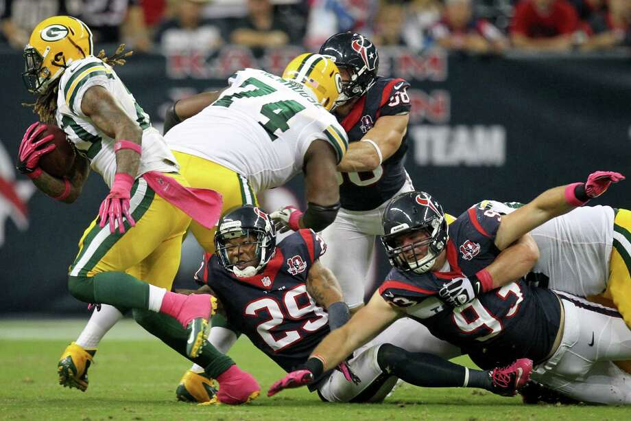 Packers running back Alex Green (20) gets pastTexans strong safety Glover Quin (29) and defensive end Jared Crick (93) during the third quarter. Photo: Nick De La Torre, Houston Chronicle / © 2012  Houston Chronicle