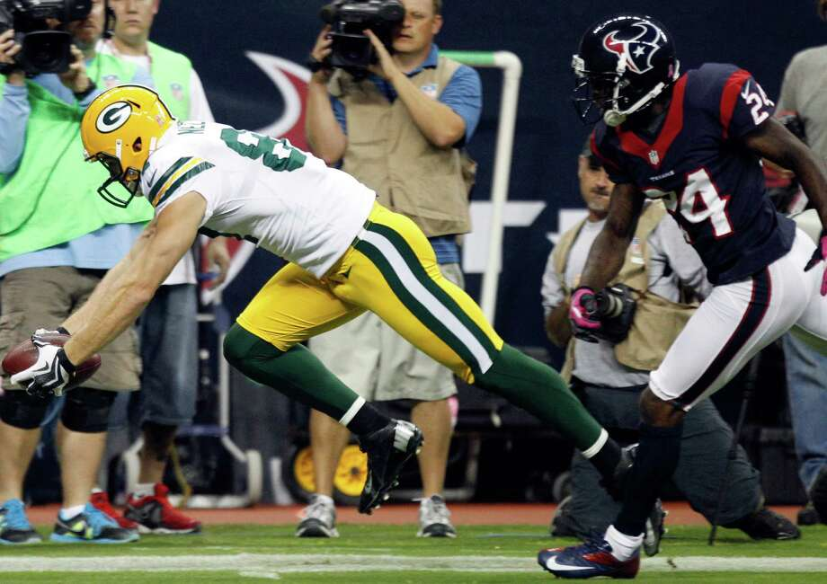 Packers wide receiver Jordy Nelson (87) beats Texans cornerback Johnathan Joseph (24) to the end zone on a 41-yard touchdown reception during the first quarter. Photo: Brett Coomer, Houston Chronicle / © 2012  Houston Chronicle