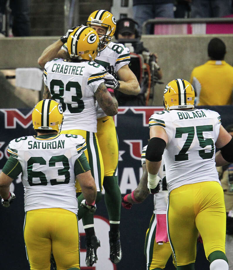 Packers wide receiver Jordy Nelson (87) celebrates with tight end Tom Crabtree (83) after scoring on a touchdown pass during the first quarter. Photo: Karen Warren, Houston Chronicle / © 2012  Houston Chronicle