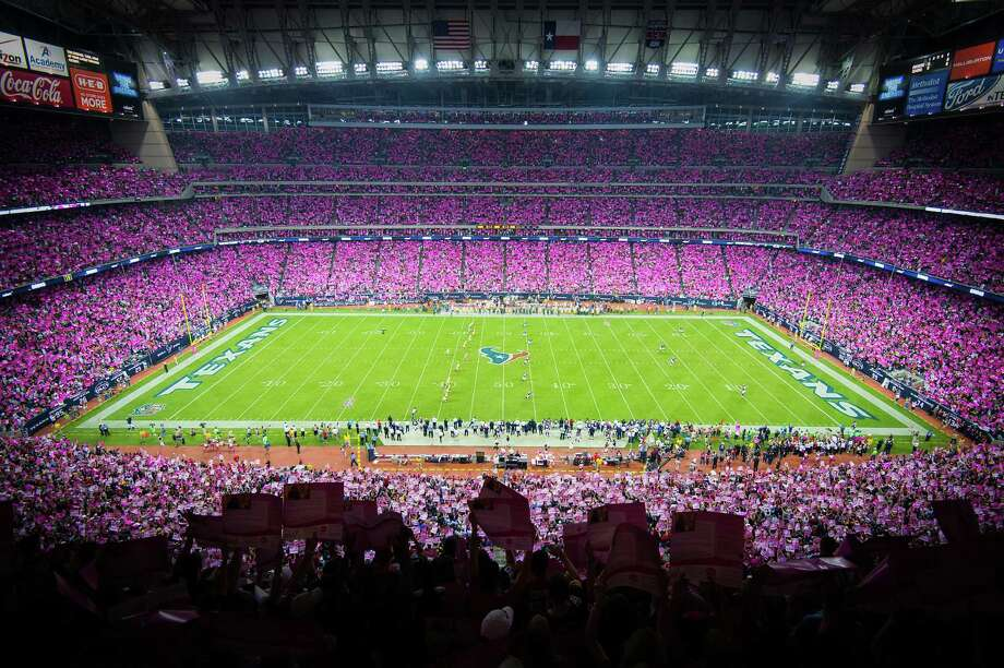 Fans paint the stadium pink with poster cards in recognition of Breast Cancer Awareness during the opening kickoff of the Green Bay Packers game against the Houston Texans at Reliant Stadium. Photo: Smiley N. Pool, Houston Chronicle / © 2012  Houston Chronicle