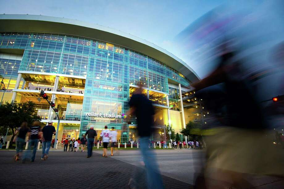 Fans stream into the stadium as night falls on the HoustonTexans game against the Green Bay Packers, their first home primetime game of the season, at Reliant Stadium. Photo: Smiley N. Pool, Houston Chronicle / © 2012  Houston Chronicle