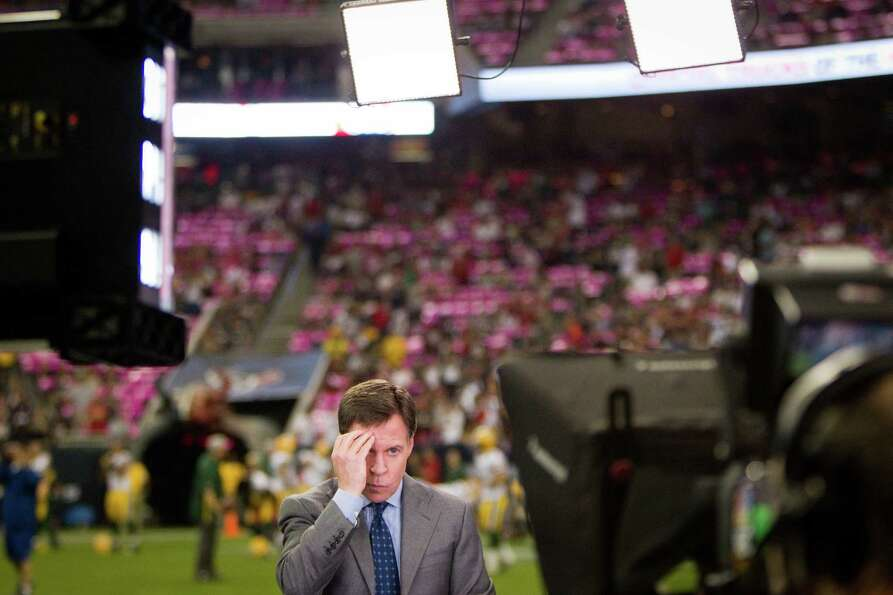 Broadcaster Bob Costas adjusts his hair before going on the air prior to the Houston Texans game aga