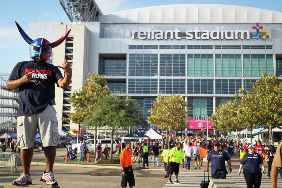 J. R. Zelaya poses for a friend's photo at Reliant Stadium. Photo: Karen Warren, Houston Chronicle / © 2012  Houston Chronicle
