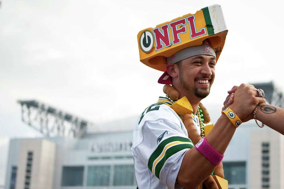 Juan Anaya, of Houston, greets fellow cheese heads as he tailgates outside Reliant Stadium. Photo: Nick De La Torre, Houston Chronicle / © 2012  Houston Chronicle