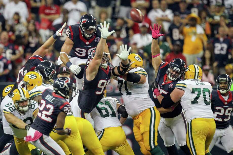 Texans outside linebacker Connor Barwin (98) jumps up onto the pile on a Green Bay Packers field goal attempt to commit a costly personal foul penalty during the third quarter. Photo: Nick De La Torre, Houston Chronicle / © 2012  Houston Chronicle